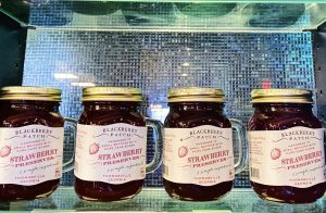 Jars of Blackberry Patch Preserves lining a shelf at the Roadhouse.